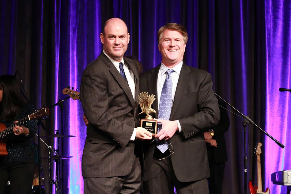 Tom Hardiman, MBI and Todd Hilde, Satellite Shelters, Inc. posing with Al Hilde's Hall of Fame Award
