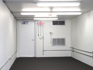 Interior shot of a modular building with exit door.