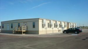 S-plex modular buildings in parking lot.
