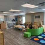 interior modular daycare facility preschool childcare room with table and chairs