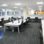 open work space with desks and chairs
